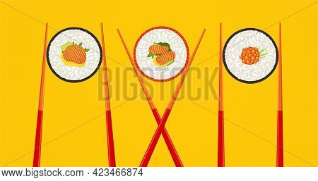 Sushi Roll With Salmon And Wooden Chopsticks On Yellow Background. Food Concept, Seafood With Rice.