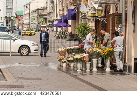 Moscow, Russia, July 27, 2020 - Ordinary City Life In Moscow. A Man In A Business Suit Walks Down Th