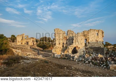 Ruins Of Churches Lighted By Sunlight In Ancient City Kanli Divane Or Canytelis, Ayaş, Turkey. Build