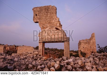 Remains Of Church Gates In Ancient City Kanli Divane Or Canytelis, Ayaş, Turkey. Ruins Of Other Buil
