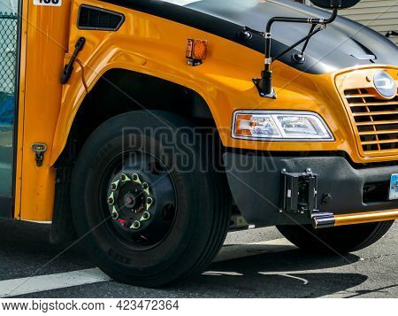 NORWALK, CT, USA - JUNE 11, 2021: Yellow school bus close up from front
