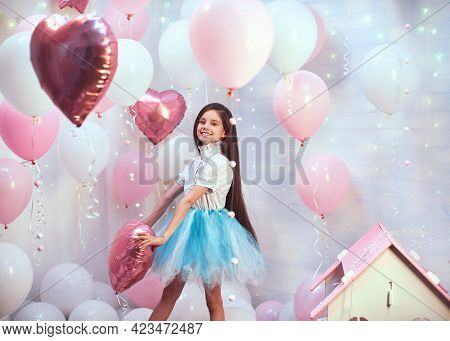 Happy Celebration Of Birthday Party With Pink Helium Balloons Of Charming Cute Little Girl In Tulle