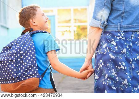 Mother Accompanies Child To School. Mother Encourages Student To Accompany Him To School. Caring Mot