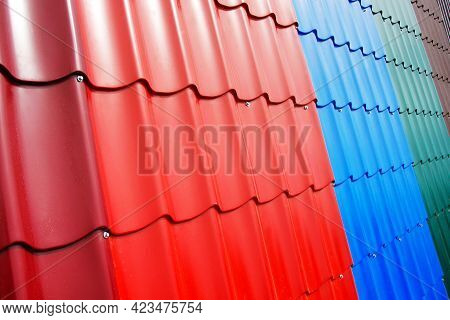 Plastic Roof Tiles For The House. Fragment Of The Roof With Samples Of Roofing Materials. Trade In B