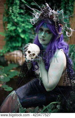 Fabulous Mermaid Siren In A Pond With A Skull Close Up