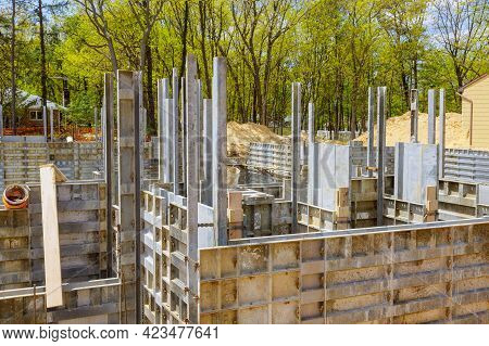 Formwork Construction Concept Unfinished House With Metal Formwork Holders