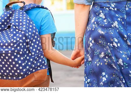 Mother Accompanies Child To School. Mom Encourages Student To Accompany Him To School. Caring Mother