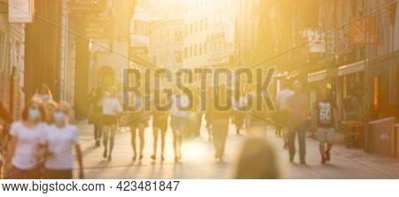 Blurred Crowd Of People On Copova Pedestrian Street In Ljubljana At Sunset. Urban Lifestyle And Mobi