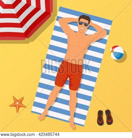 Man On The Beach. Summer Time. Man Wearing Lying On The Beach On A White And Blue Striped Towel. Guy