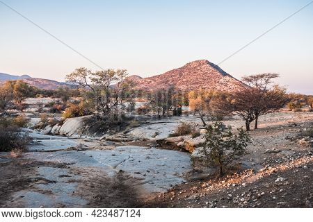 Etendero Mountain And Dry Riverbed In The Savanna Of The Erongo Region In Namibia, Africa