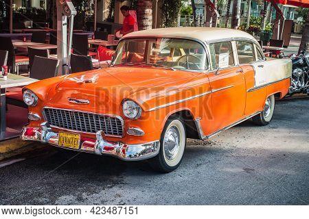 Miami, United States - July 7 2012: 1955 Chevrolet Chevy Bel Air 4 Door Sedan In Orange,  2400 C Ser