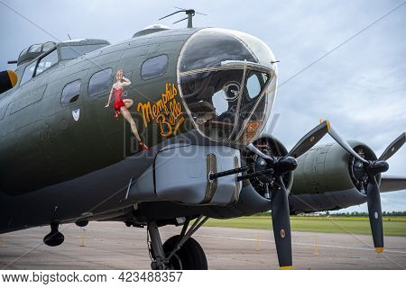 Duxford England May 2021 Front View Of The B17 Sally B Bomber, Double Barreled Gun Turret In The Nos