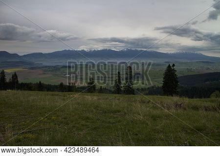 The Liptovska Mara Dam And The Western Tatras Mountains From Top Of Mountain Predna Magura.
