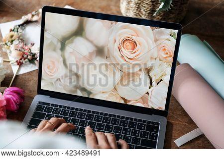 Florist using a floral laptop screen mockup