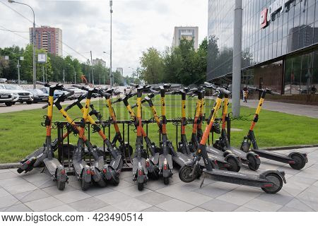 Parking For Electric Scooters In The Square Near The Shopping Center. City Electric Scooter Rental S