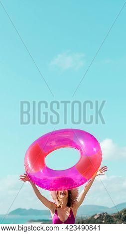 Girl in a bikini holding a pink swim tube mobile phone wallpaper