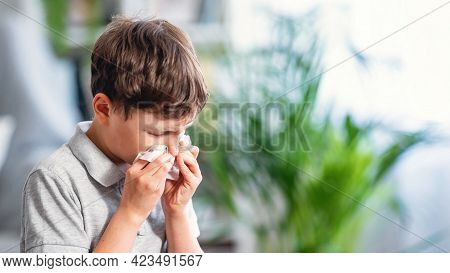 Sick Boy Blows His Nose Into Cloth, Unhealthy Child Suffers From Inaccurate Shot Mucus From The Nose