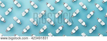 Fluorescent Light Bulb Pattern On Blue Background.
