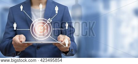 Targeting The Hr Business Concept, Businessman Holding Tablet And Arrow Dart To Virtual Target Dart