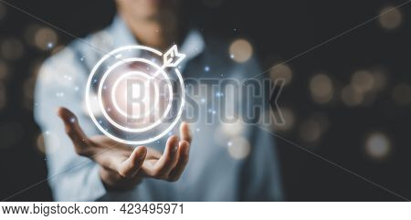 Businessman Hand Holding A Target With A Dart, Point To A Darts Aiming At The Target Center Business