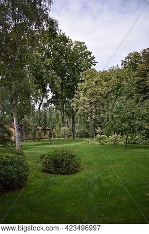 Peaceful Garden. Beautiful Garden With A Freshly Mowed Lawn. Landscaping Panorama Of Nice Home Garde