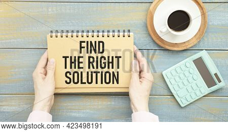 Find The Right Solution. Businessman Holding A Card With A Message Text Written On It