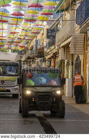 Jerusalem, Israel - June 3rd, 2021: Colorful Umbrellas Hanging Over A Jerusalem, Israel, Street, And