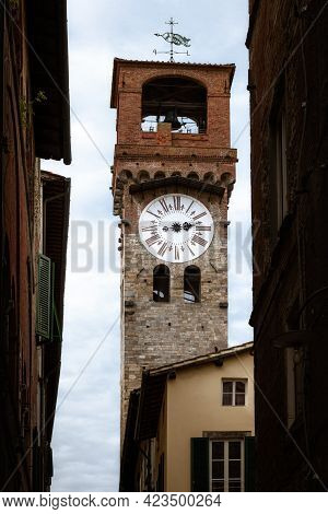 Famous Torre Delle Ore (tower Of The Hours), Ancient Medieval Turret Clock In The Town Center Of Luc