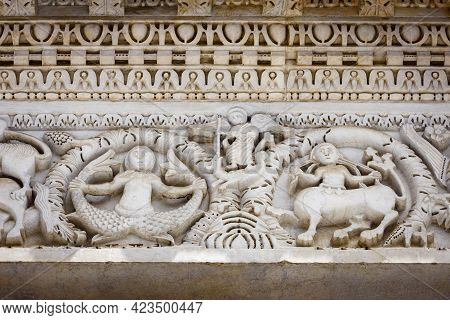 Lucca (tuscany, Italy), Church Of San Michele. Details Of The Columns And Arches Of The Medieval Fac