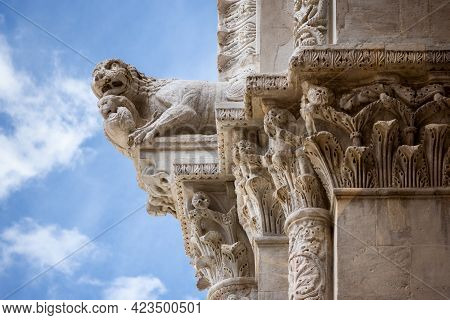 Lucca (tuscany, Italy). Detail Of The Facade Of The Cathedral Of San Martino, With A Lion Shaped Mon