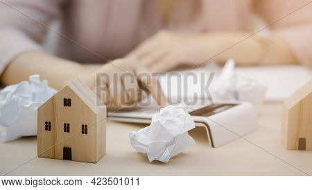 Woman Using Calculator Machine Managing Household Finances At Home, Bank Calculates The Home Loan Ra