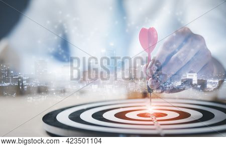 Targeting The Business Concept, Businessman Touch Red Arrow Dart To The Virtual Target Dartboard, Ex