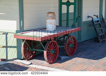 Retro Vintage Antique Railway Train Warehouse Building With Red And Green Luggage Wheel Card On A Re
