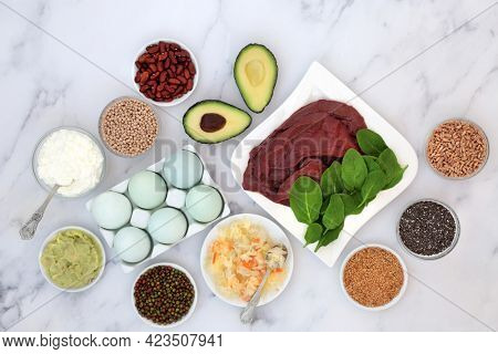 Health food to help bi polar disorder an manic depression high in omega 3, protein, selenium, magnesium, serotonin and  tryptophan. Dairy, meat, seeds, legumes, vegetables, grains. On marble.