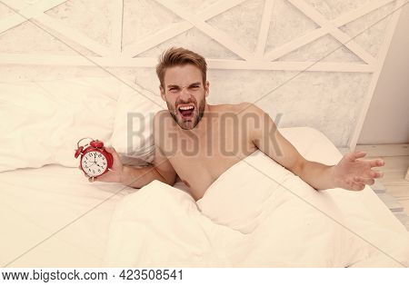 Man Sleeping Bed White Bedclothes And Red Alarm Clock, Feeling Irritated Concept