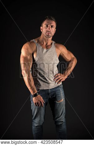 Hustle To Gain More Muscle. Fit Guy With Muscular Arms Black Background. Sportsman Show Biceps Trice