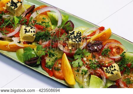 Mediterranean Style Heirloom Tomato Salad With Onions, Olives, Herbs And Cheese