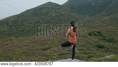 Woman do yoga beside the sea beach