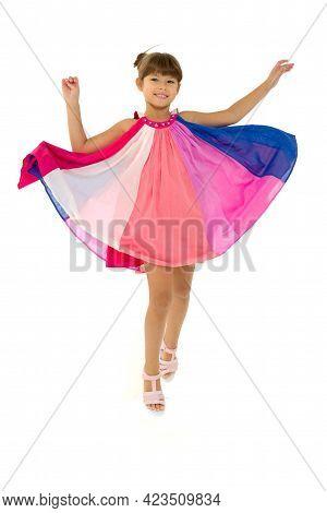 Full Length Shot Of Happy Girl In Fluttering Dress. Joyful Lovely Girl Happily Jumping On Isolated W