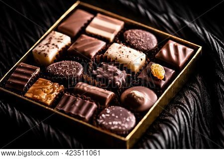 Swiss Chocolates In Gift Box, Various Luxury Pralines Made Of Dark And Milk Organic Chocolate In Cho