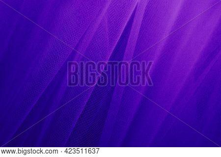 Purple tulle drapery textured background