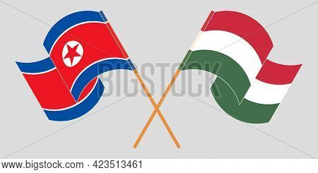 Crossed And Waving Flags Of North Korea And Hungary