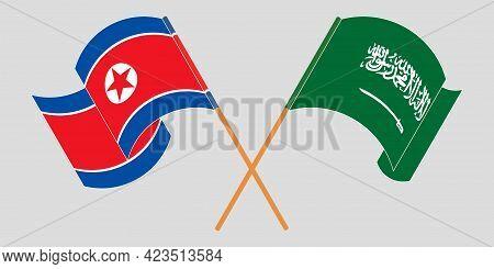 Crossed And Waving Flags Of North Korea And The Kingdom Of Saudi Arabia