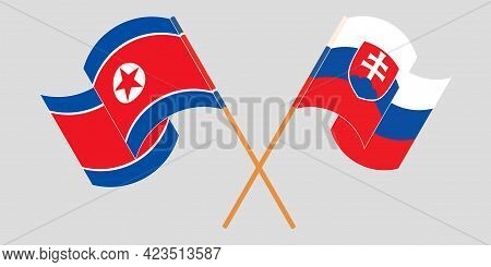 Crossed And Waving Flags Of North Korea And Slovakia