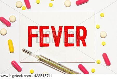 Fever Word Made With Building Blocks. Wooden Block With Words Fever With Stethoscope On The Table, I
