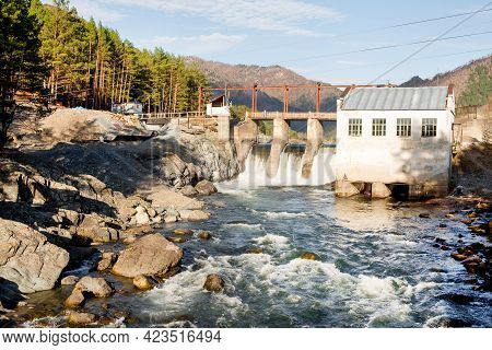 Old Dam With Flowing Water On River. Hydroelectric Power Station, Hydro Energy.