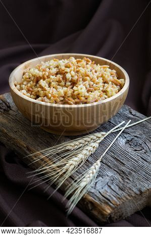 Traditional Turkish Food Bulgur Pilaf With Barley Noodle In Bowl On Wooden Background