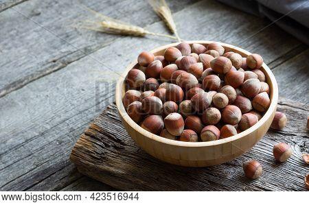 Hazelnut, Heap Or Stack Of Hazelnuts On Wooden Background, Healthy Food