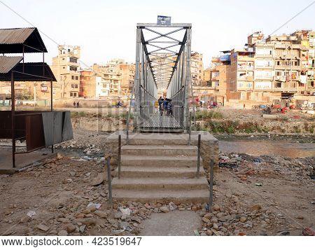 Landscape Thamel Old Town City And Nepali People Children Walking On Steel Suspension Bridge Crossin