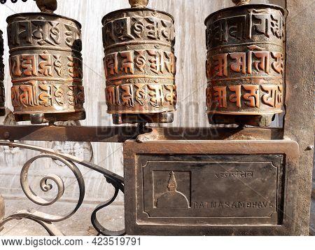 Metal Brass Prayer Wheels On Wall Of Hariti Shrine Or Ajima Hindu Temple At Swayambhunath Pagoda Or